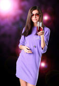 Portrait of young nice woman with glass of wine — Stock Photo
