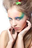 Vacker kvinna med färg smink — Stockfoto