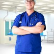 Stock Photo: Young man doctor hospital room