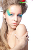 Beautiful woman with color makeup — Stock Photo