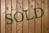 Sold on wood — Stock Photo