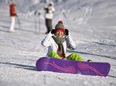 Beautiful woman snowboarder — Stock Photo