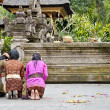 Indonesian woman praying - Stock Photo