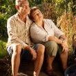 Senior couple in garden — Stock Photo #3944485