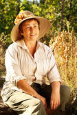 Portrait of senior woman in straw hat — Stock Photo