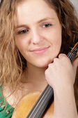 Sadly smiling woman with violin — Stock Photo