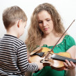 Mother teaches son play violin — Foto Stock