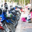 PATTAYA, FEBRUARY 28: Busy scooter parking on Jomtien street, Fe - Stock Photo
