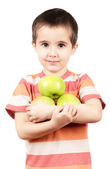 Little boy holding apples — Stock Photo