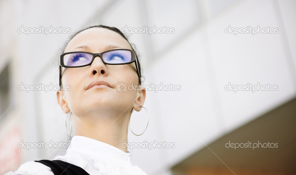 Young woman with glasses outside, natural soft light and selective focus — Stock Photo #5331422