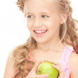 Little girl with green apple — Stock Photo