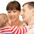 Happy mother and father with adorable baby — Stock Photo