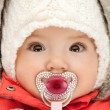 Adorable baby with pacifier - Stock Photo