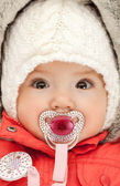 Adorable baby with pacifier — Stock Photo