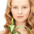 Woman with green sprout — Stock Photo #5282458