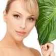 Woman with green leaf — Stock Photo #5282466
