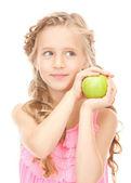 Niña con manzana verde — Foto de Stock
