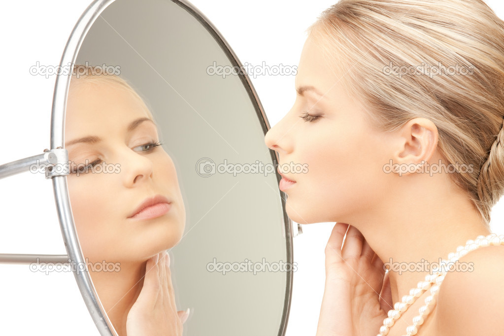 Picture of beautiful woman with pearl beads and mirror  Stock Photo #5291068
