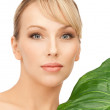 Woman with green leaf — Stock Photo #5302377