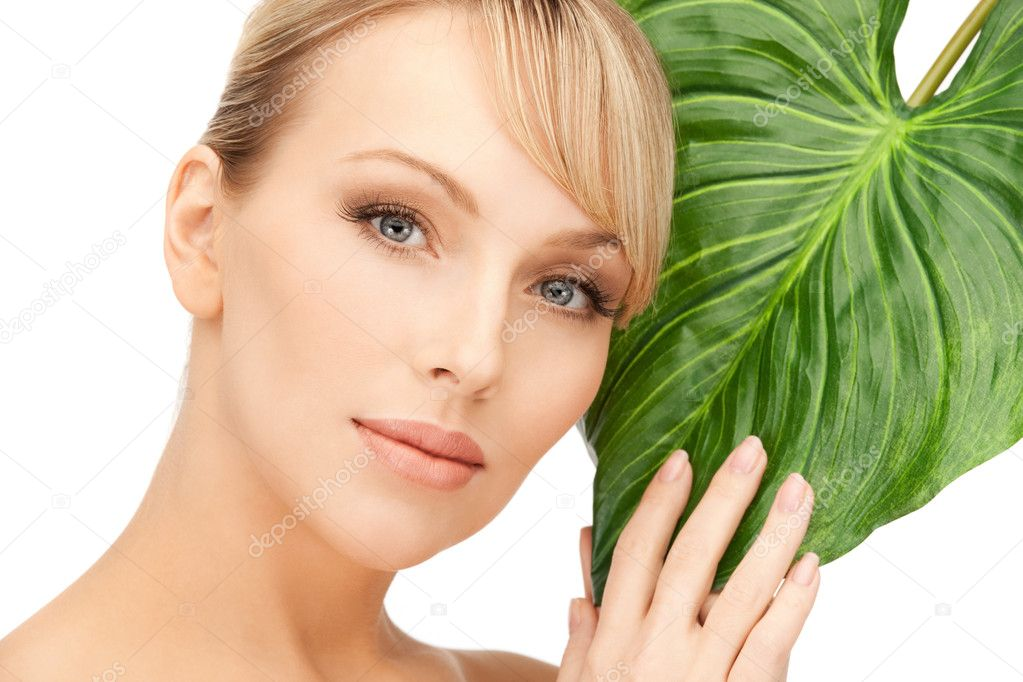 Picture of woman with green leaf over white — Stock Photo #5309358
