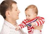 šťastný otec s roztomilé dítě — Stock fotografie