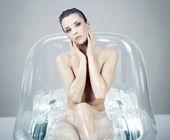 Beautiful brunette relaxing in bath — Stock Photo