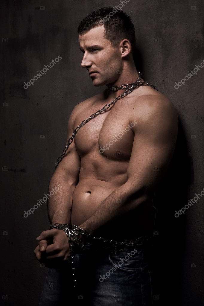 Young male model well build with chains over his body  Stock Photo #5290190