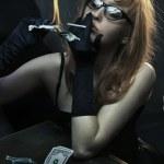 Sexy young woman smoking cigarette — Stock Photo