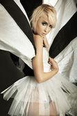 Amazing blonde girl in beautiful dress — Stock Photo