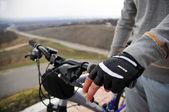 Hands on a bike handlebar — Stock Photo