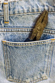 Wrench inside jeans pocket — Stock Photo