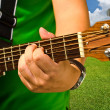Hand playing the guitar — Stock Photo