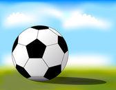 Ballon de football sur l'herbe — Vecteur