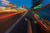 Car driving fast in the night city — Stok fotoğraf