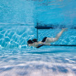 A young girl after the jump float under water — Stock Photo #4060702