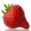 A red strawberry, isolated on a white background — Zdjęcie stockowe
