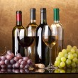 Bottles, glasses and grapes — Stock Photo #4131083