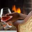 ������, ������: Resting at the burning fireplace fire with a glass of cognac