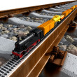 A miniature model of the train rides on big tracks - Stock Photo