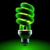 Green energy-saving lamp — Stock Photo