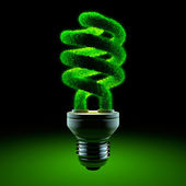 Green energy-saving lamp — Stock Photo