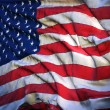Flag of the United States, fluttering in the breeze, backlit ris — Stock Photo
