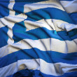 Flag of Greece, fluttering in the breeze, backlit rising sun — Stock Photo
