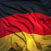 Flag of Germany, fluttering in the breeze, backlit rising sun — Stock Photo