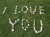 Io amo lei trama scritta con pietre — Foto Stock