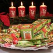 Christmas gifts and decorative candles — Stock Photo
