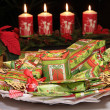 Christmas gifts and decorative candles — Stock Photo #4365086