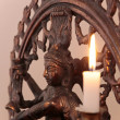 Statue of the goddess Shiva with candle — Stock Photo