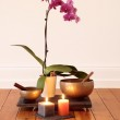 Orchids, candles and singing bowl — Stock Photo #5224706