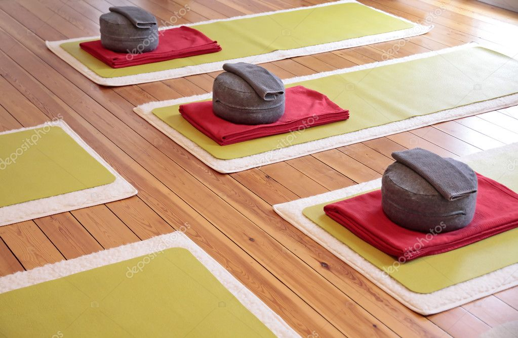 Close-up of yoga mats and yoga cushion in a yoga studio — Stock Photo #5223958